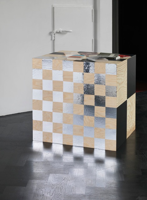 Karl Holmqvist<br /> Untitled (Chess Cube), 2013<br /> Vinyl on wood, selection of books<br /> 80 x 80 x 80 cm, Photo: Jens Ziehe