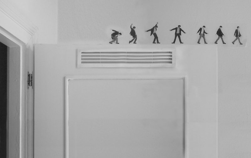 Ioan Godeanu, the project manager of the Construction & Deconstruction Institute presents himself walking taking individual steps as a trapeze artist on the edge of the door to the kitchen (the heart of home). He is here without any institutional support in the form of language, product, or logo design.   <br />