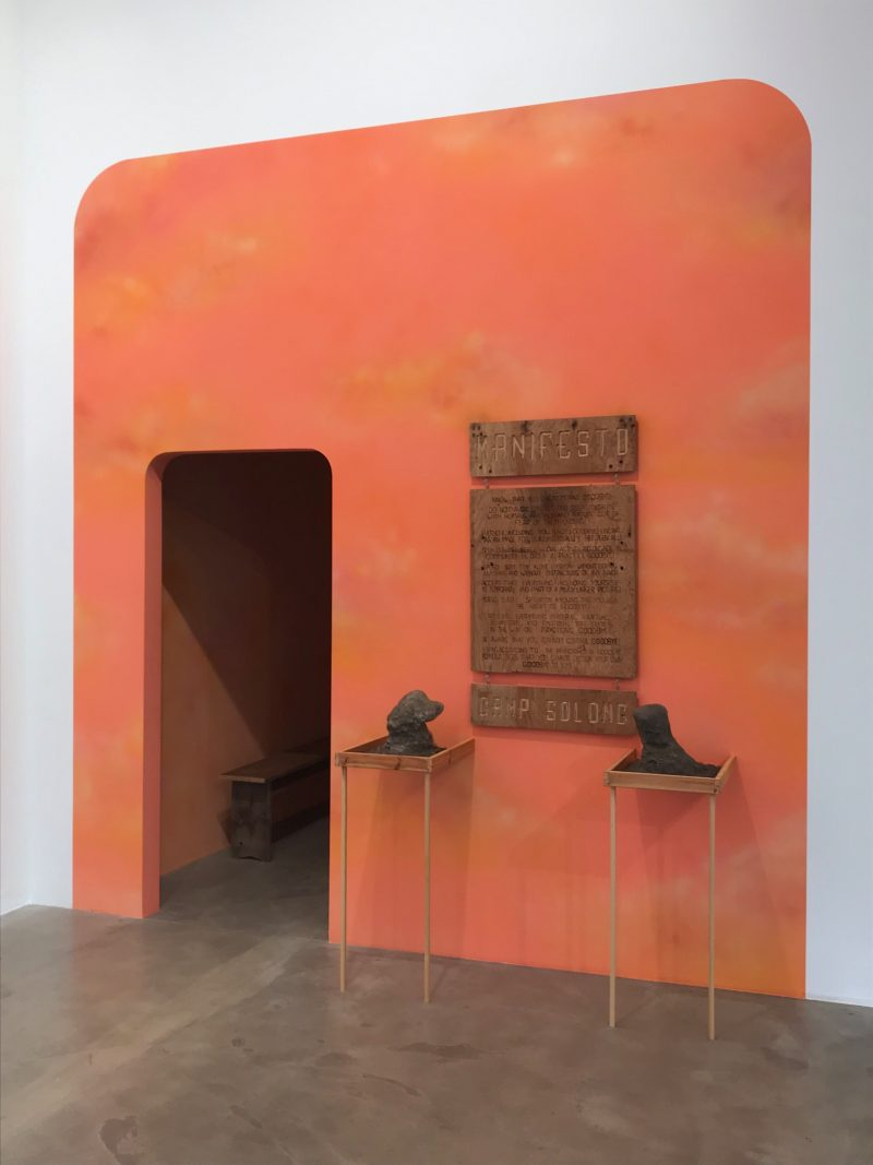 Dafna Maimon & Ethan Hayes-Chute<br /> Camp Solong: Still Digging, 2019<br /> Acrylic paint, wood, polyurethane foam, dirt, video/sound (20:54)<br /> Installation view at nbk